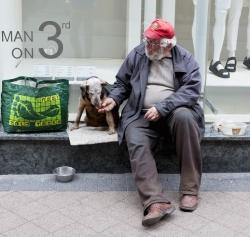 Man Feeding his Dog_Budapest crop